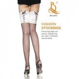 Fishnet stockings, wide white lace suspender