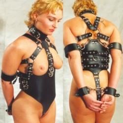 Bondage slave - submissive woman harness